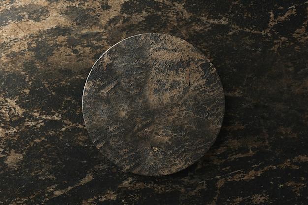 Vista superiore dell'esposizione di marmo nera del prodotto su fondo astratto. podio vuoto del piedistallo per mostrare. rendering 3d.