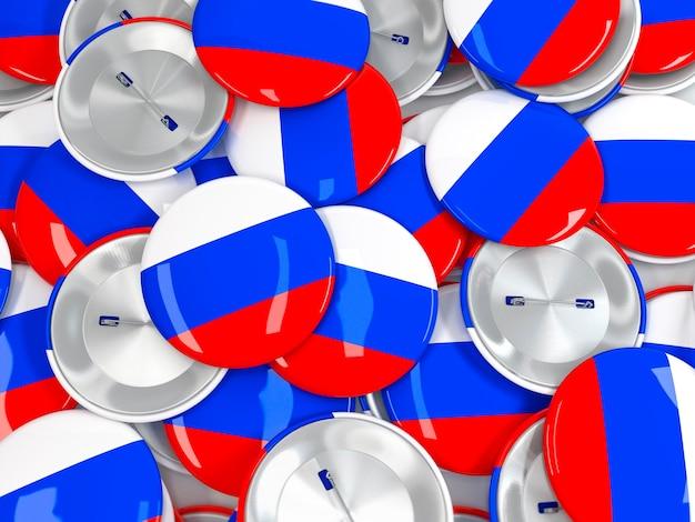 Vista dall'alto dei badge dei pulsanti con la bandiera della russia. rendering 3d realistico