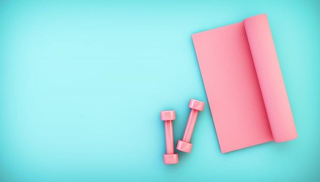Vista superiore dell'attrezzatura rosa di yoga sul pavimento blu