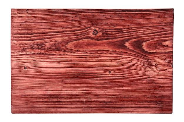 Vista dall'alto di una piccola tavola testurizzata dipinta in una tinta rossa con un motivo a riccio più chiaro che emerge in uno stile piatto, isolato su uno sfondo bianco.