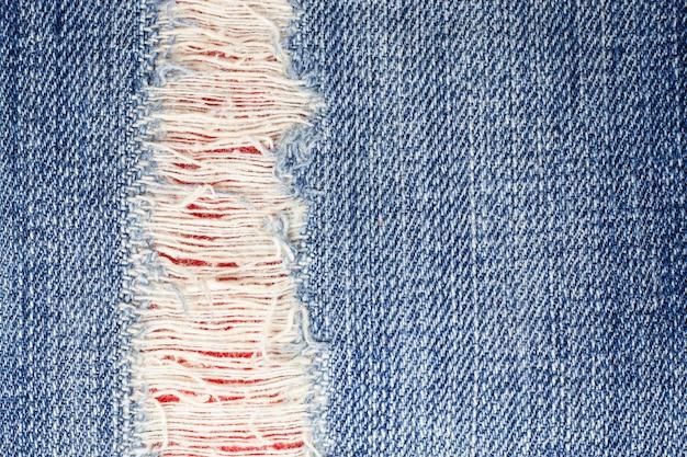 Trama di jeans denim strappato.