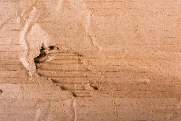 Bordi strappati foglio di cartone marrone ondulato di texture di carta