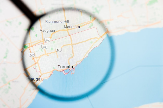 Concetto illustrativo di visualizzazione della città di toronto, canada sullo schermo di visualizzazione tramite la lente d'ingrandimento