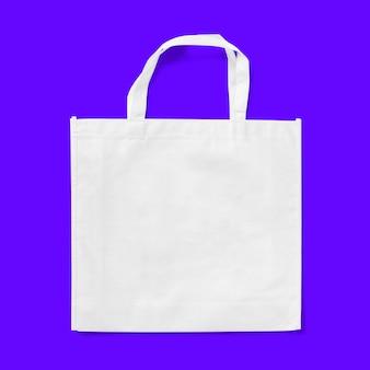 Tote bag tessuto panno shopping sacco mockup isolato su sfondo blu.