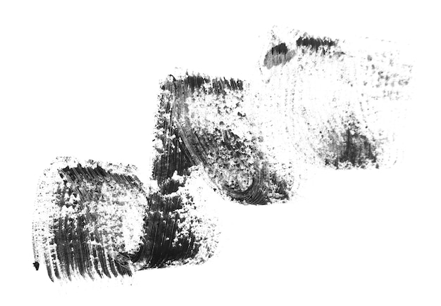 Traccia dall'inchiostro per le ciglia. su un tavolo bianco.