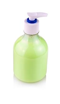 Bottiglia di plastica trasparente con sapone liquido per le mani verde.