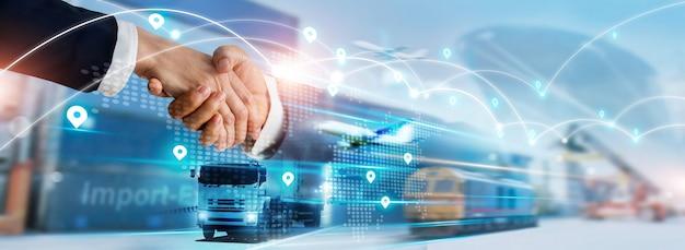 Trasporto e logistica stretta di mano dell'uomo d'affari della partnership logistica della rete globale