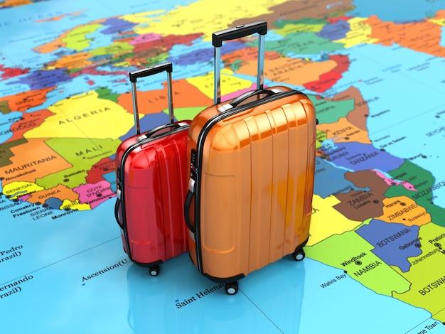 Concetto di viaggio o turismo. bagagli sulla mappa del mondo. 3d