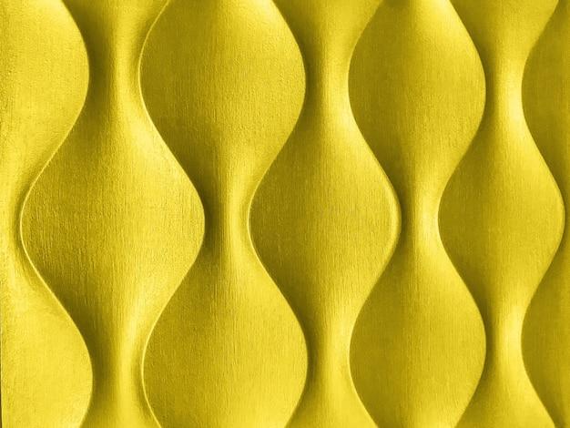 Colore di tendenza dell'anno 2021 giallo luminoso. sfondo decorativo interno 3d dorato con forma geometrica ondulata.