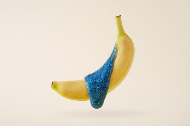Concetto minimale di tendenza di banana volante contemporanea e melma fluente