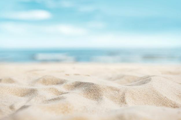 Fondo tropicale della spiaggia di sabbia di estate