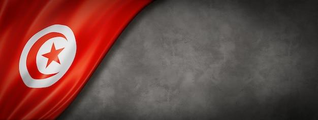 Bandiera della tunisia sul muro di cemento