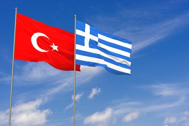 Bandiere della turchia e della grecia sopra il fondo del cielo blu. illustrazione 3d
