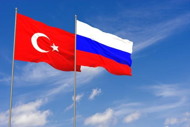 Bandiere della turchia e della russia sopra il fondo del cielo blu. illustrazione 3d