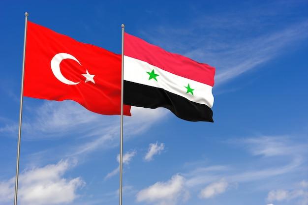 Bandiere della turchia e della siria sopra il fondo del cielo blu. illustrazione 3d