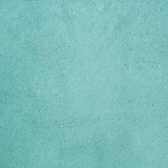 Sfondo turchese con effetto muro di cemento