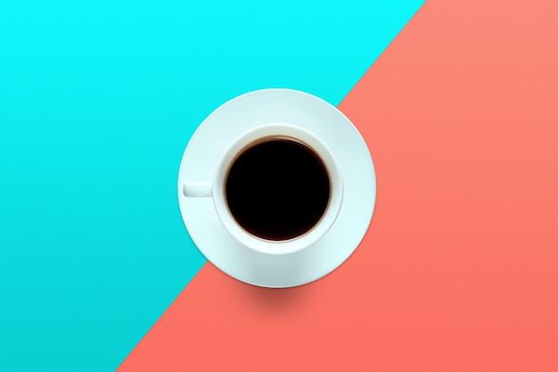 Tazza di caffè turchese su un colore turchese e corallo