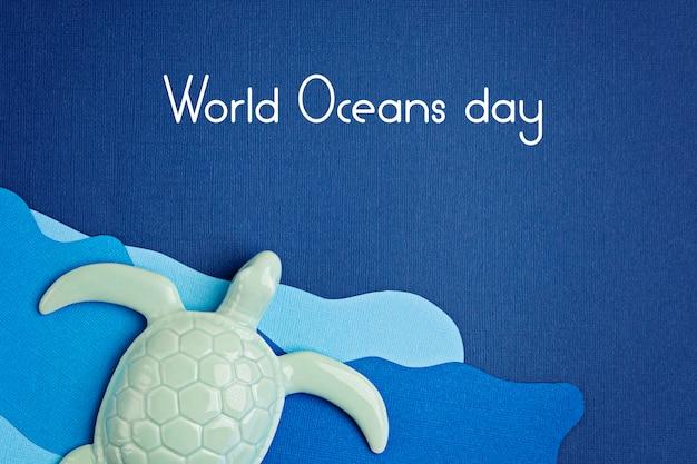 Tartaruga e carta tagliata per la giornata mondiale degli oceani