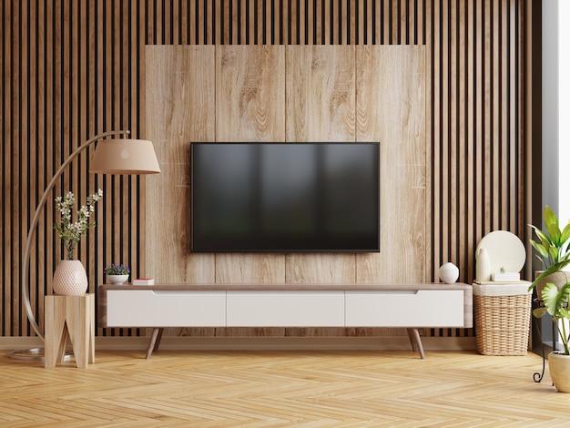 Tv sul mobile in una stanza buia con una parete in legno scuro. rendering 3d
