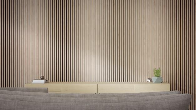 Porta tv vicino alla parete di legno del luminoso soggiorno e divano contro mobile in casa moderna o appartamento.