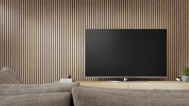 Porta tv vicino alla parete di legno del luminoso soggiorno e divano contro la televisione in casa moderna o appartamento.