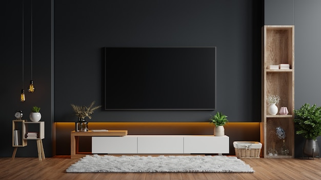 Tv montata a parete in una stanza buia con una parete nera. rendering 3d