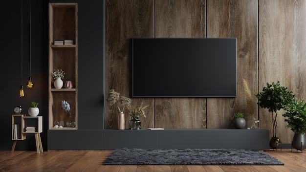 Tv montata a parete in una stanza buia con una parete in legno scuro. rendering 3d
