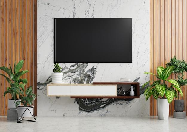 Tv sul muro di marmo bianco del soggiorno