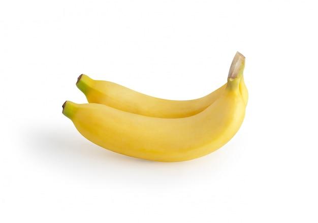 Due banane isolate sui precedenti bianchi