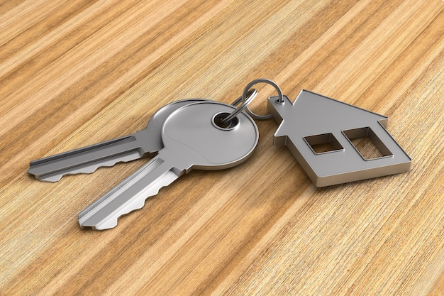 Due chiavi e casa di gingillo su superficie di legno. illustrazione 3d