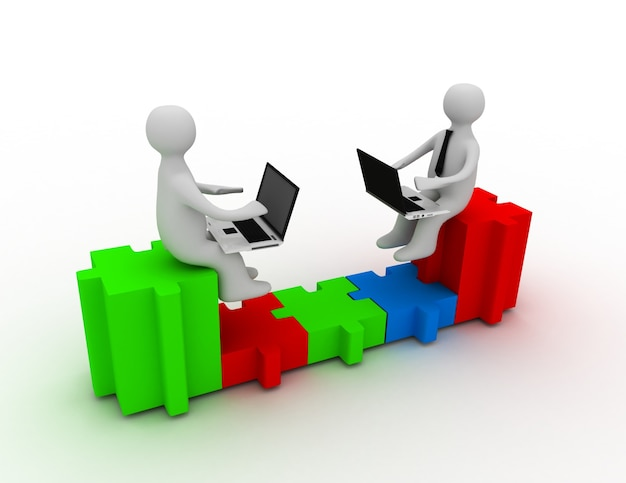 Due persone con laptop sedute sui pezzi di un puzzle sono collegate