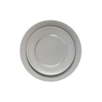 Due piatti rotondi in ceramica uno sull'altro, isolati su sfondo bianco. disposizione piatta, vista dall'alto