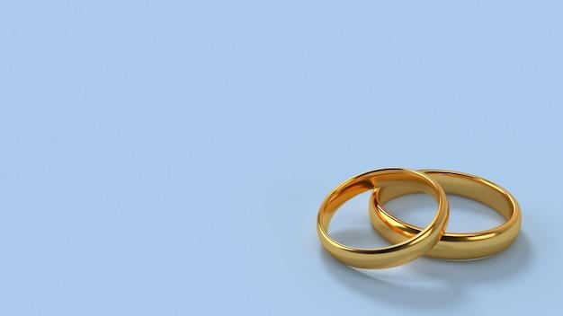 Due fedi nuziali d'oro giacciono l'una sull'altra con uno sfondo spaziale per il formato del testo 16x9