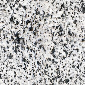 Piastrella uniforme, struttura del pavimento in granito, granito. sfondo chiaro in pietra naturale.