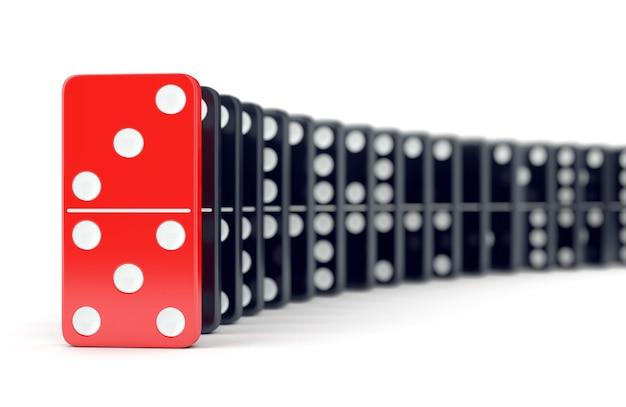Tessera del domino rossa unica e molti domino neri. leadership, individualità e concetto di differenza.