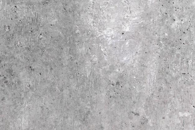 Muro di cemento non trattato con intonaco, riparazioni nell'appartamento, fondo in cemento