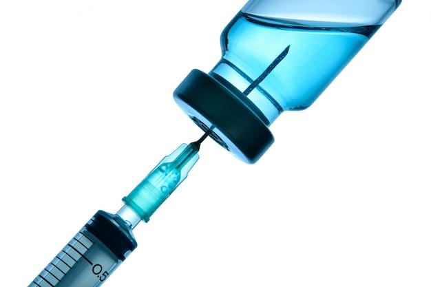 Bottiglia per vaccino e siringa