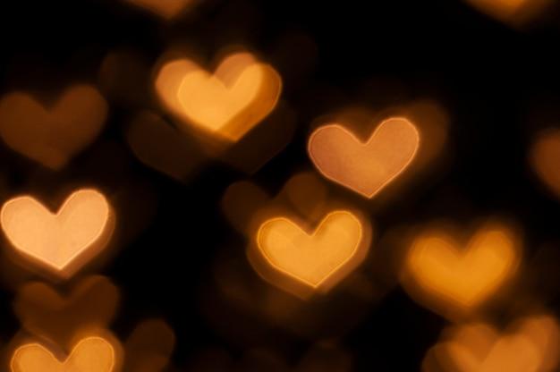 Sfondo di san valentino con luci bokeh a forma di cuore