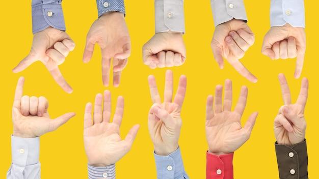 Vari gesti delle mani maschili tra loro. relazioni linguistiche dei segni nella società.