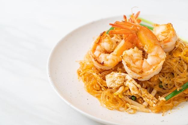 Vermicelli pad thai o thai saltati in padella vermicelli con gamberetti - stile di cibo tailandese