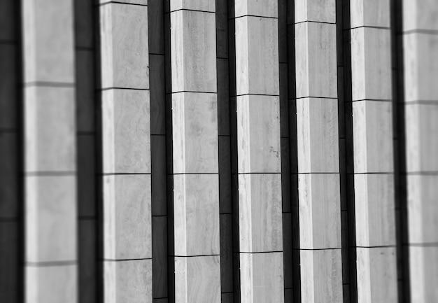 Fondo verticale di struttura della parete di cemento bianco e nero hd