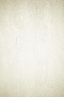 Fondo verticale della parete della pittura della superficie della pietra di cemento marrone verticale