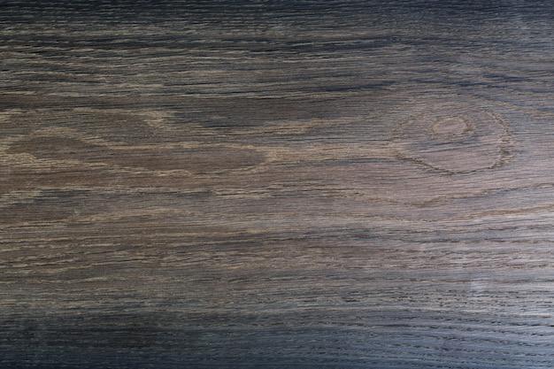 Texture molto scura di legno nero lucido. sfondo di quercia.