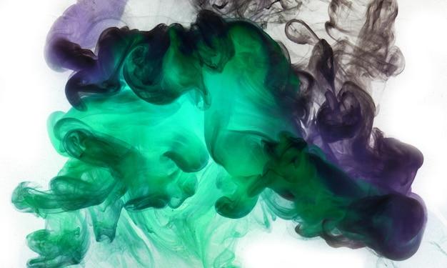 Colori vibranti, sfondo astratto fumo luminoso. spruzzata di vernice in acqua, nuvola colorata in movimento. concetto di narghilè, sfondo di profumo, carta da parati danza
