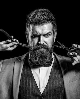 Vintage barbiere rasatura ritratto barba uomo baffi uomini ragazzo brutale forbici rasoio a mano libera