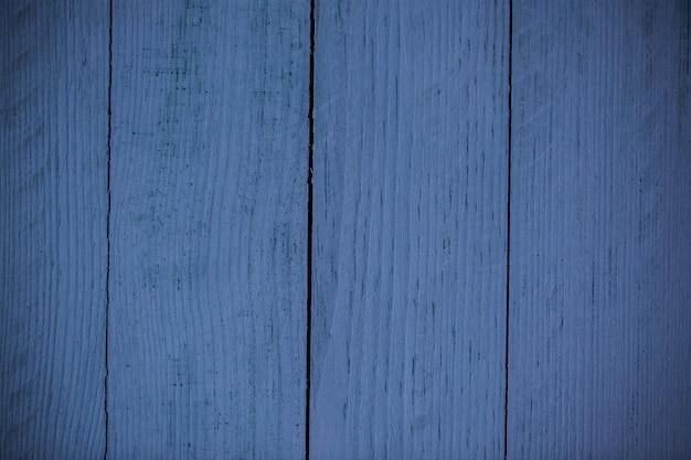 Trama di sfondo legno blu vintage con nodi e fori dei chiodi. vecchio muro di legno dipinto.