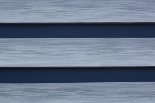 Fondo d'annata di struttura di legno blu di un muro di casa