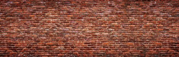 Struttura del muro di mattoni d'epoca. sfondo panoramico della vecchia pietra.