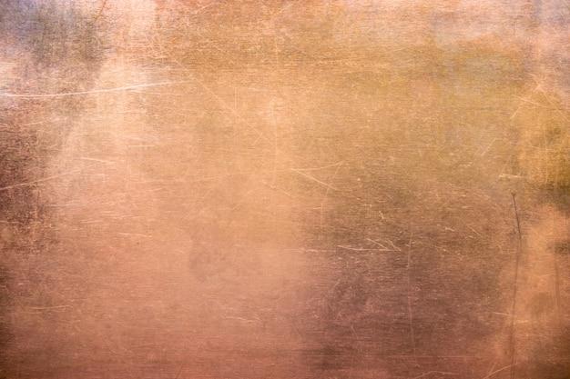 Piastra in bronzo o rame vintage, lamiera di metallo non ferroso come backg Foto Premium