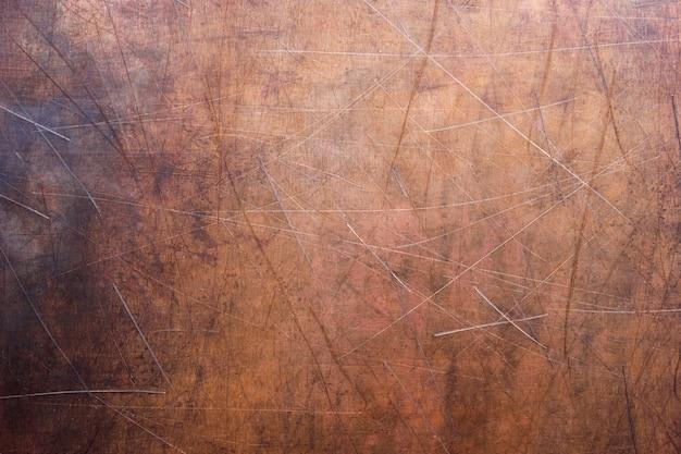 Piatto vintage in bronzo o rame, lamiera non ferrosa come sfondo